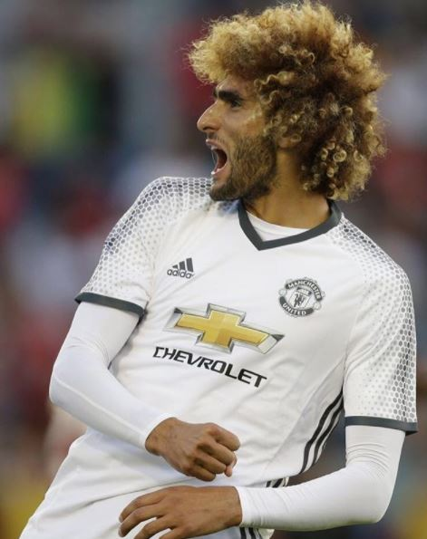 Fellaini really large curly afro style brown hair with blonde ends