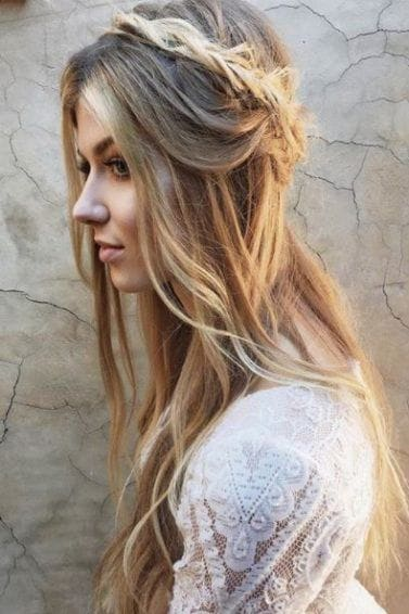 long blonde tousled wavy hair with half-up crown braid worn with white dress shown from the side view