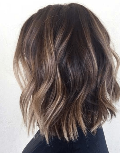 Long bob dark brown hair with golden blonde balayage finish with waves