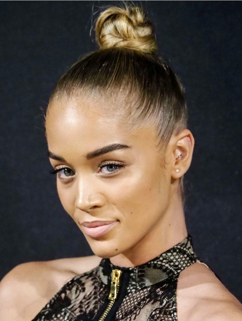 prom updos: model jasmine sanders with her golden bronde hair in a slicked back twisted updo