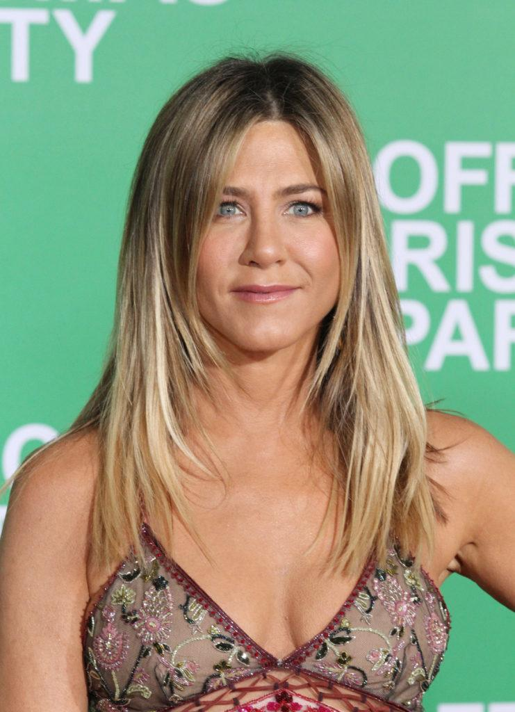 actress jennifer aniston with long blonde hair with face framing layers