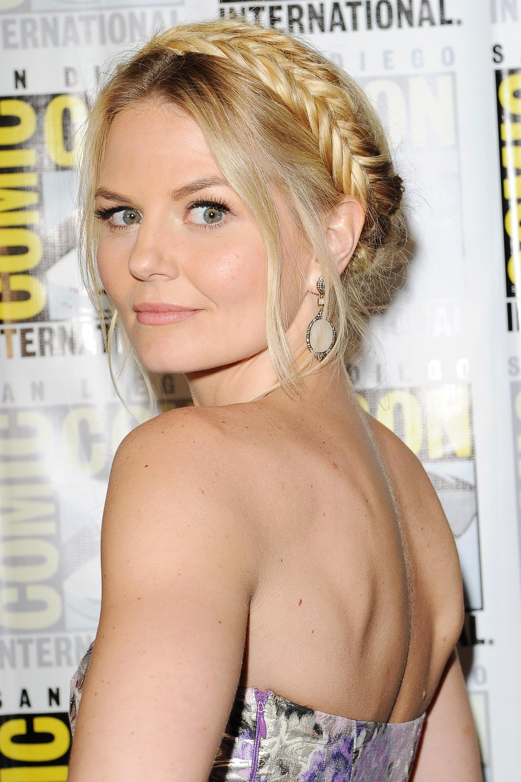 prom hairstyles for medium hair: jennifer morrison with blonde hair styled in milkmaid braids wearing a strapless dress