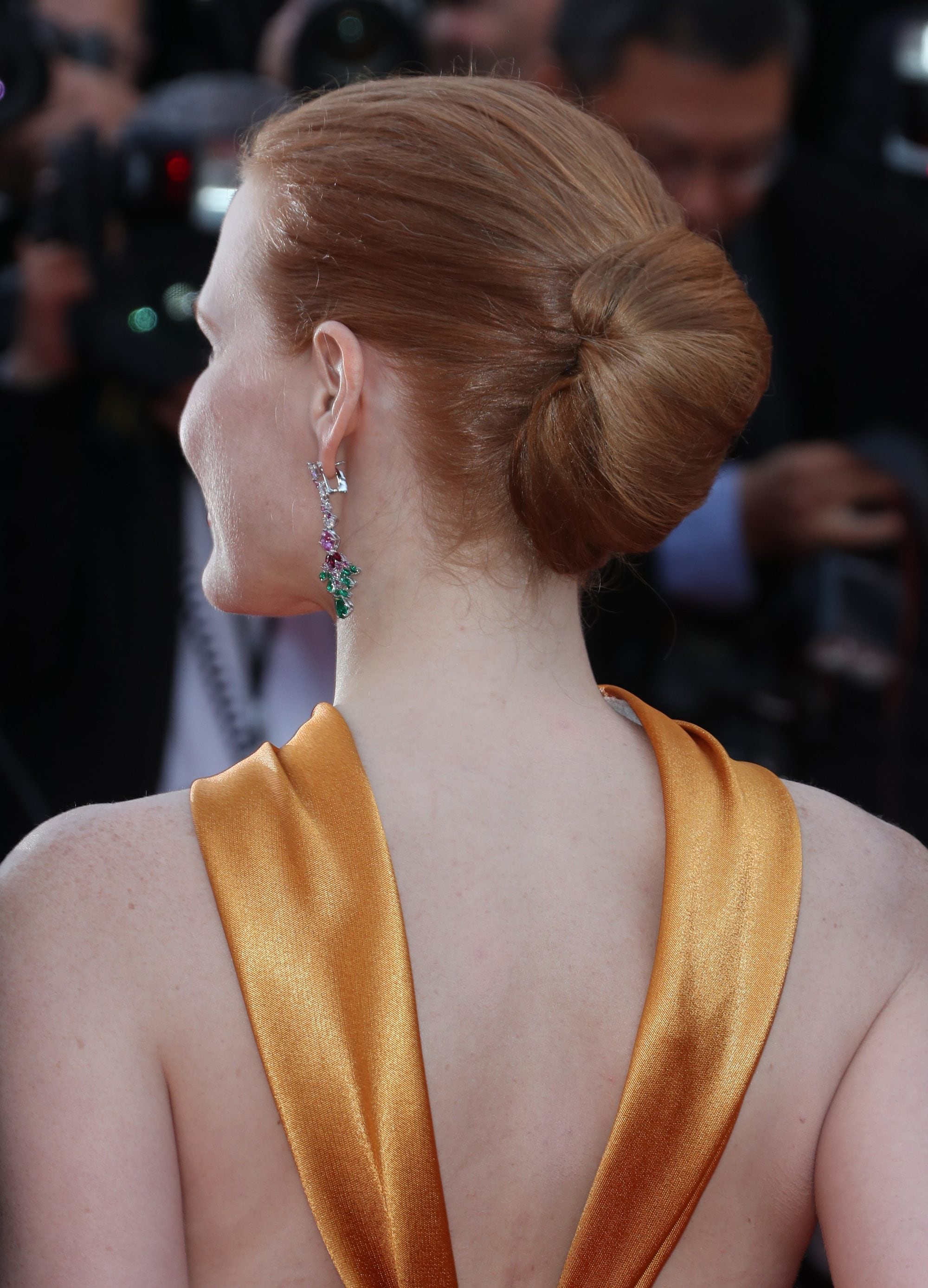prom updos: back shot of jessica chastain with classic french twist hairstyle on the Cannes film festival red carpet
