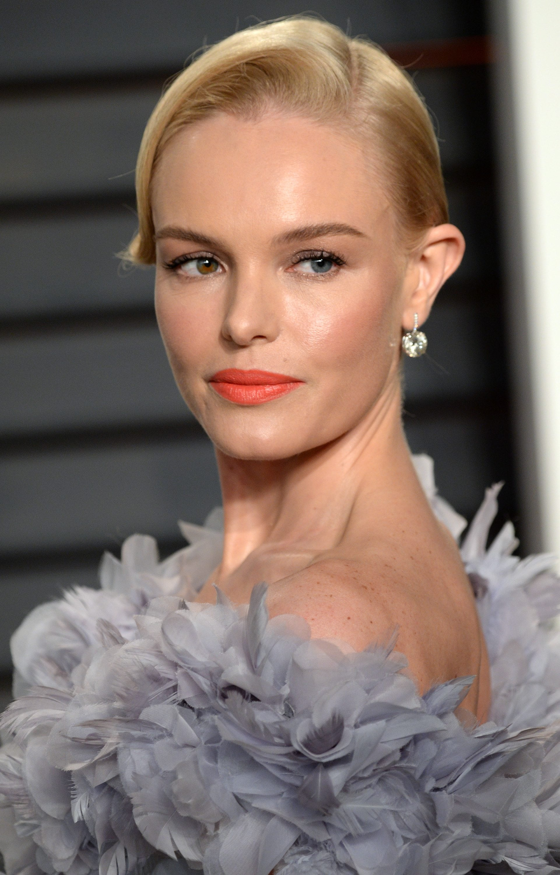prom hairstyles for medium hair: kate bosworth light blonde straight hair styled in a side parted bun updo