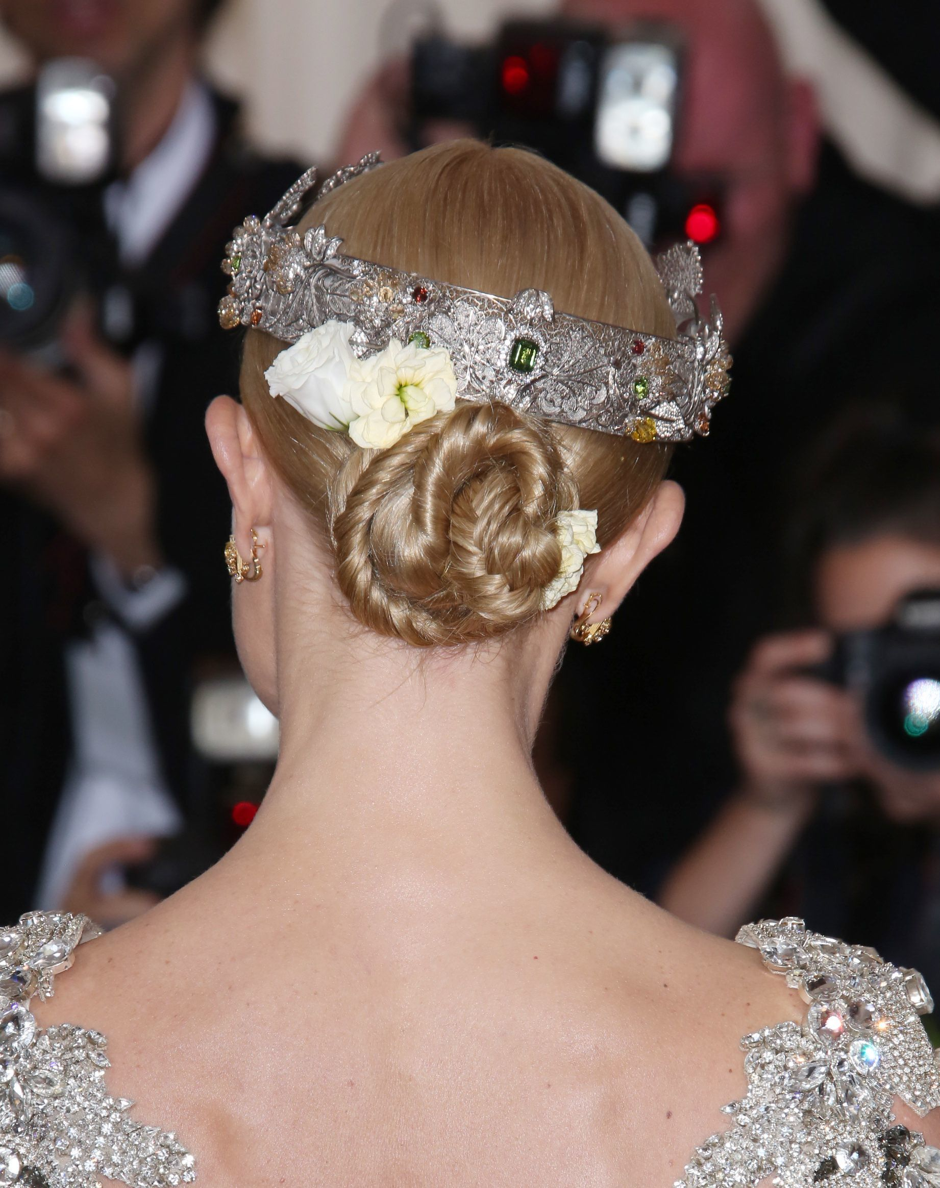prom updos: back shot of kate bosworth with sleek twisted floral updo hairstyle at the met gala