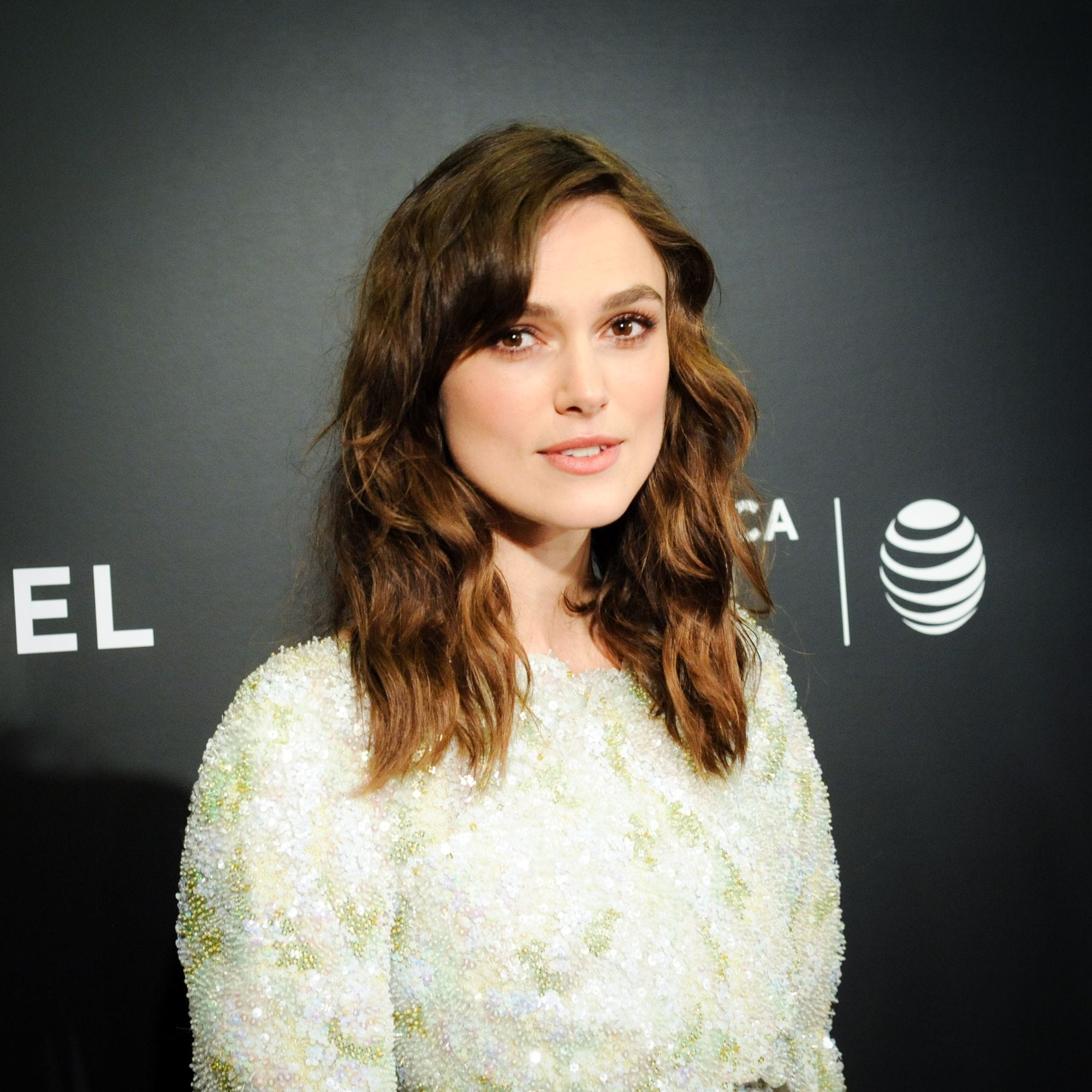 actress keira knightley with brunette tousled hair and a short side fringe