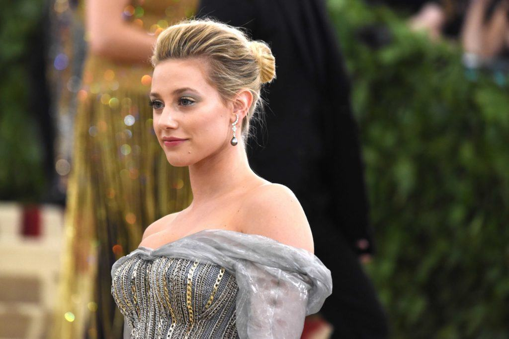 prom updos: Riverdale star Lili Reinhart at the met gala with her blonde hair in a coiffed updo