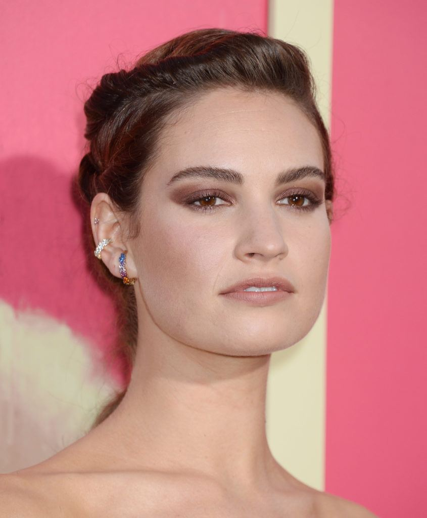 prom updos: actress Lily James with her light brown hair in an updo with a twisted detail