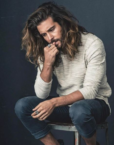 Male model with long tousled brown hair hipster hair