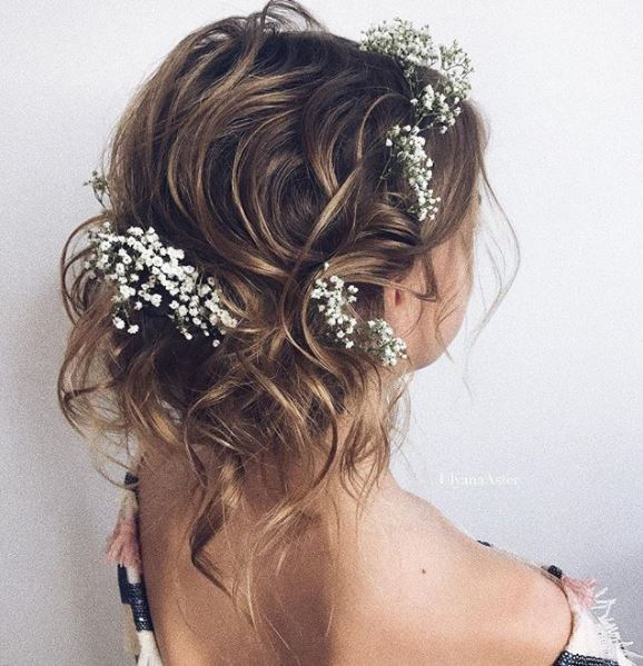 Light brown balayage hair with wavy pinned up finish and baby's breath flowers