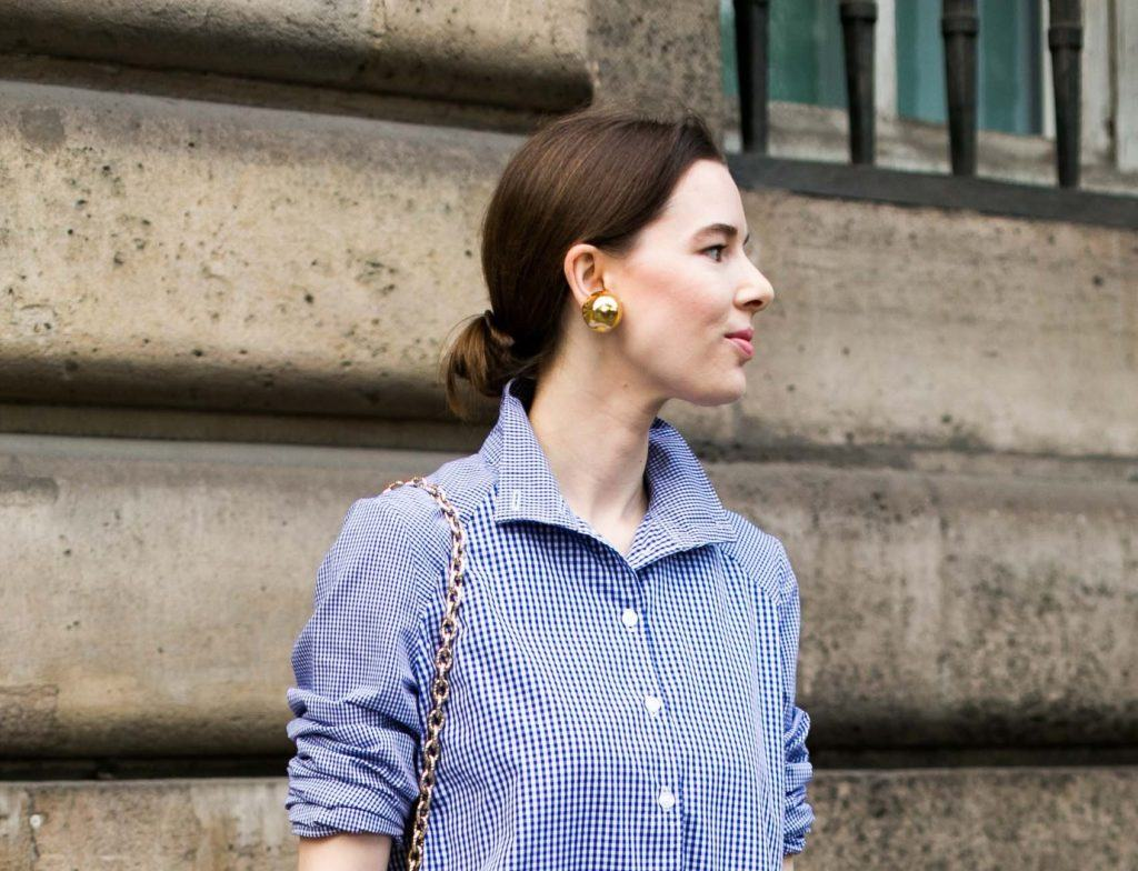 shot of woman on the street with sleek low bun hairstyle