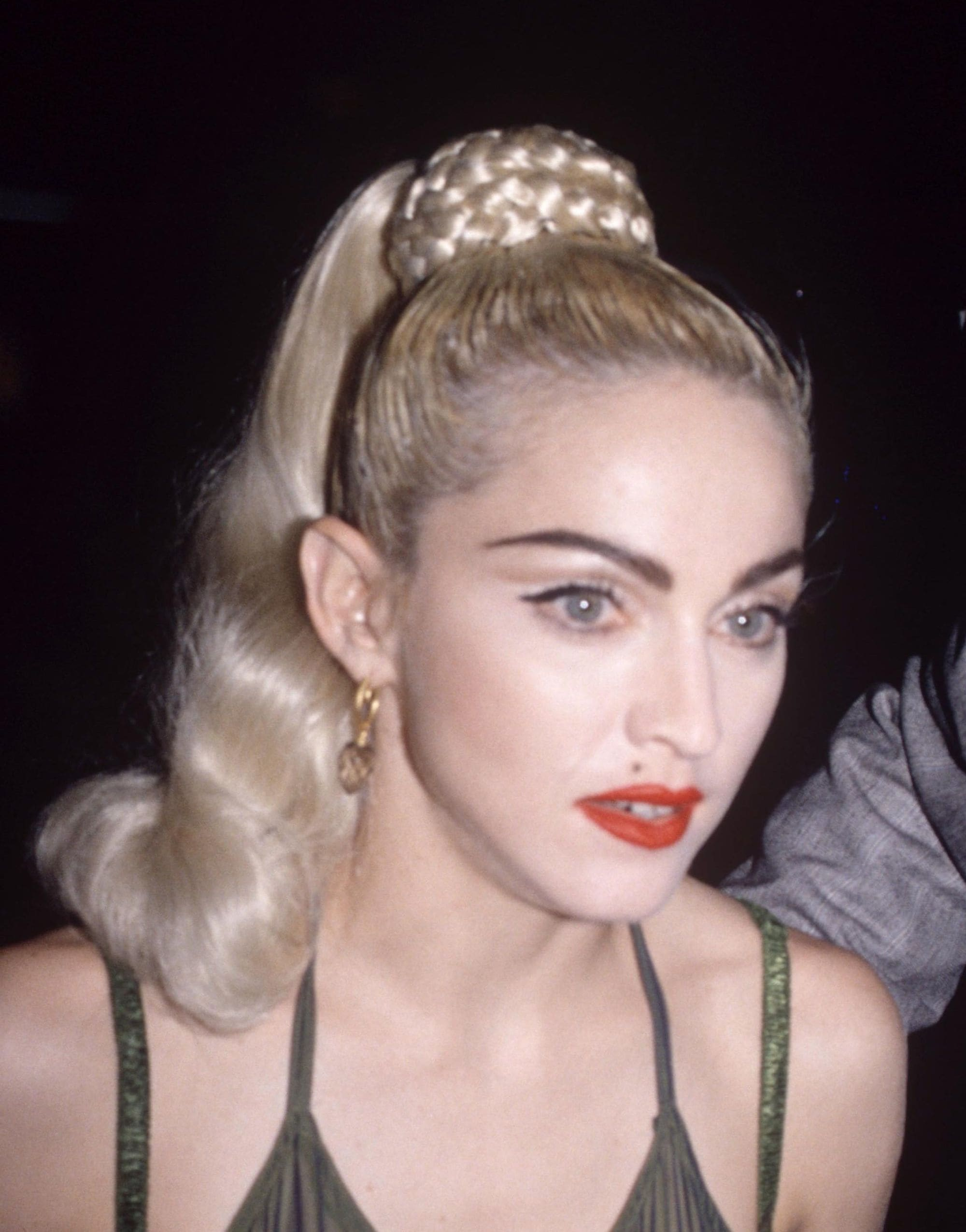 Madonna in 1990 with her iconic Blond Ambition braided high ponytail