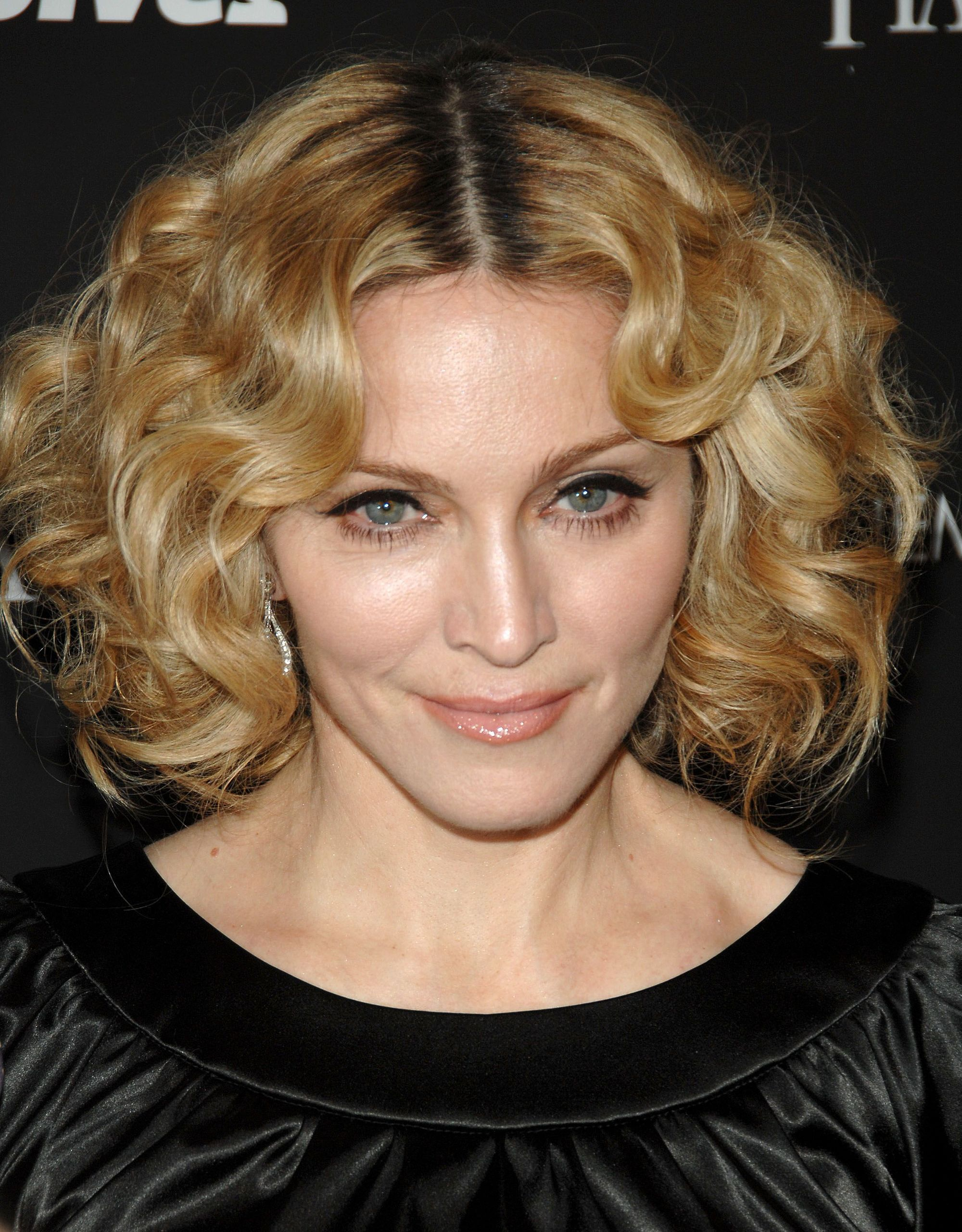 Madonna in 2007 with short curly honey blonde hair with a centre parting