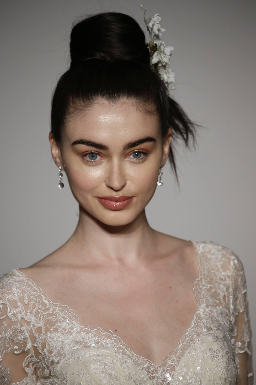 simple wedding hairstyles: model with sleek updo on the runway