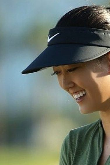 shot of american golfer michelle wie on the golfing pitch smiling