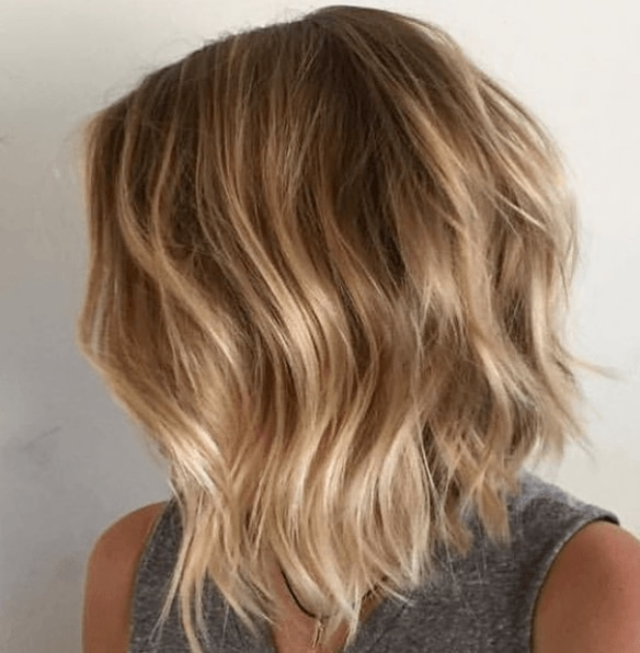 long bob graduated bob haircut with brown to blonde balayage hair with wavy finish