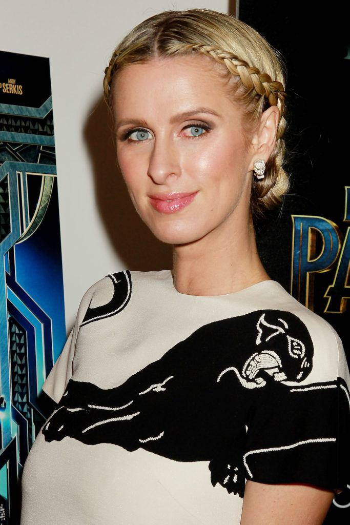 prom updos: Nicky Hilton Rothschild with her blonde hair in a braided chignon style