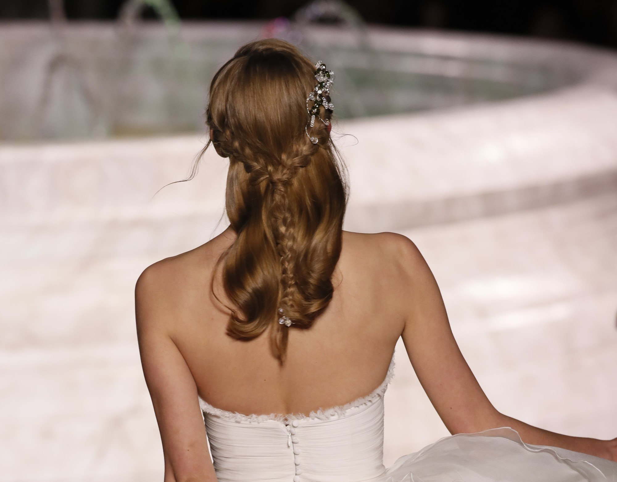 backstage picture of woman with half up half down hairstyles