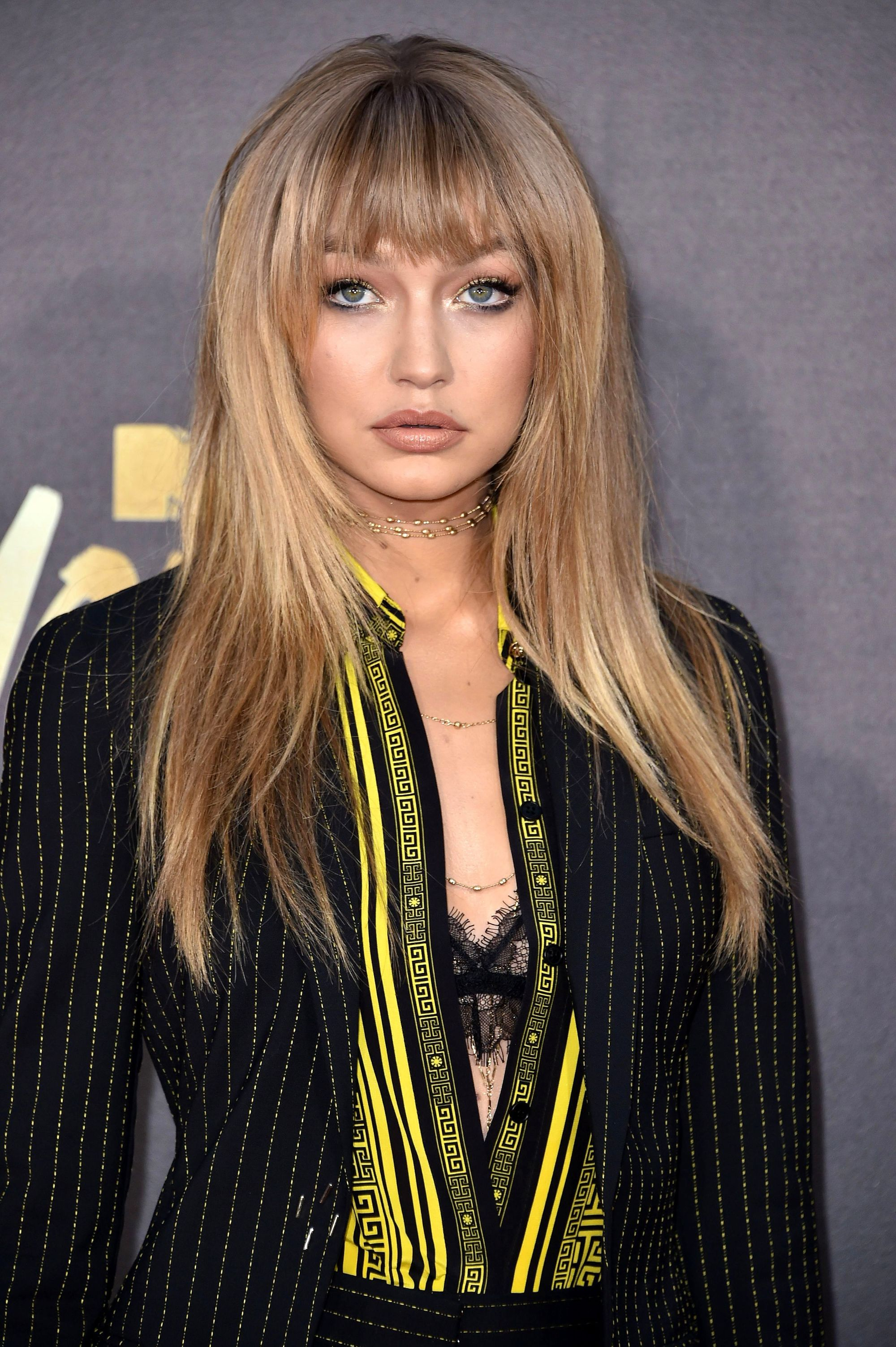 Gigi Hadid with long straight hair and full bangs fringe