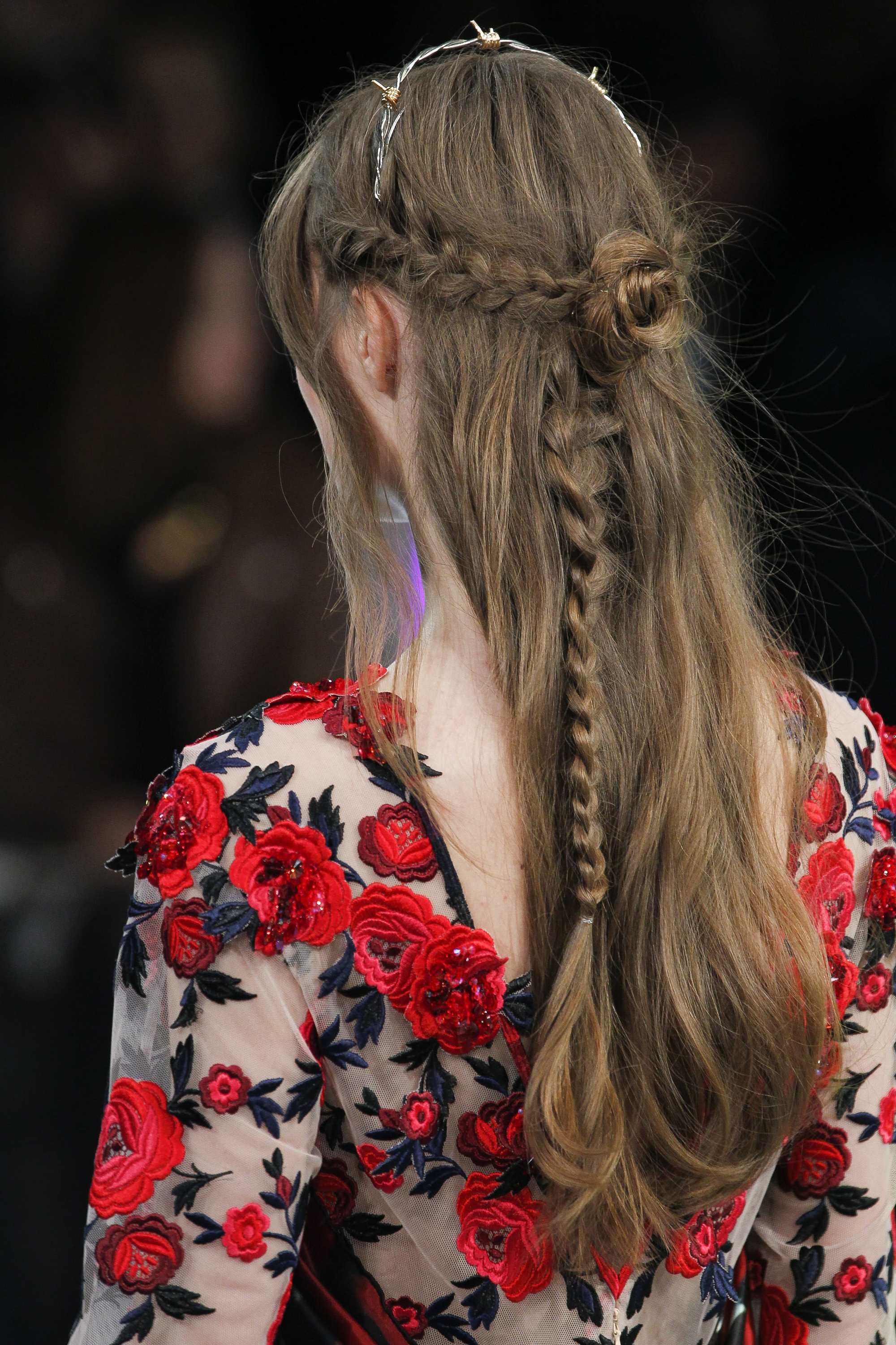 half down prom hairstyles: backshot of model with rose braid hairstyle at rodarte