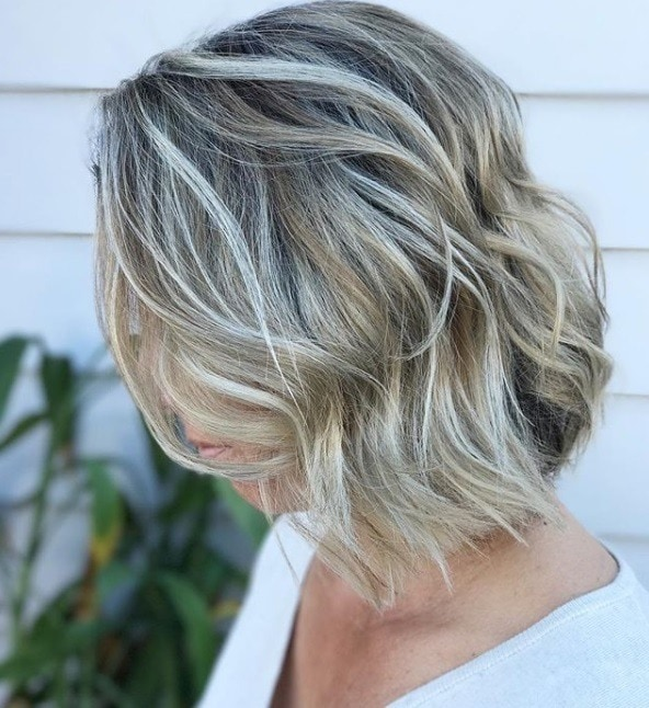 Silver blonde hair 9 reasons why this striking hue is our latest woman with wavy short blonde bob with silver highlights running through it outside pmusecretfo Image collections