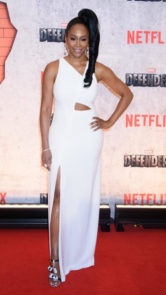 Simone Missick wears her long black tresses in high side ponytail worn with white floor length dress in the red carpet