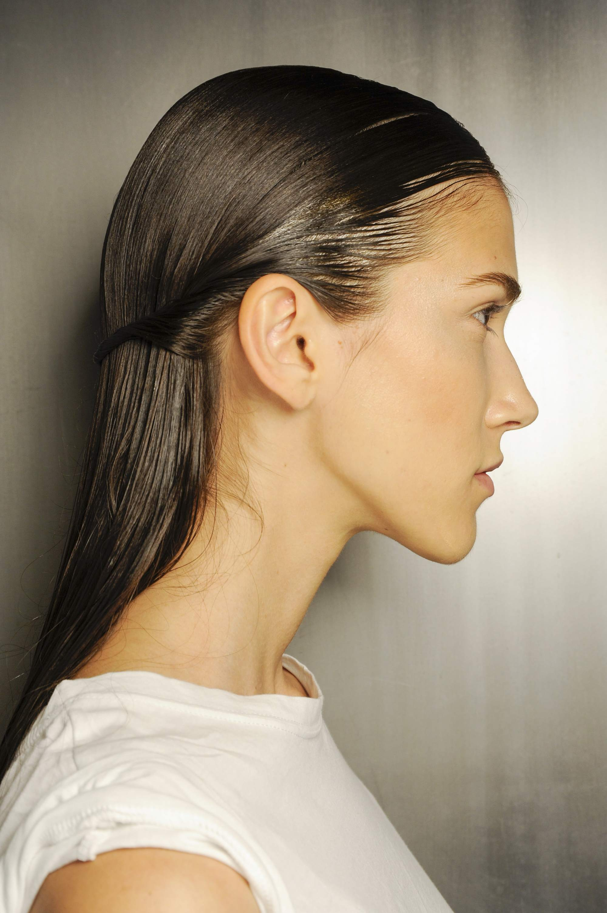 side shot of model with sleek hair half-up and down at thakoon