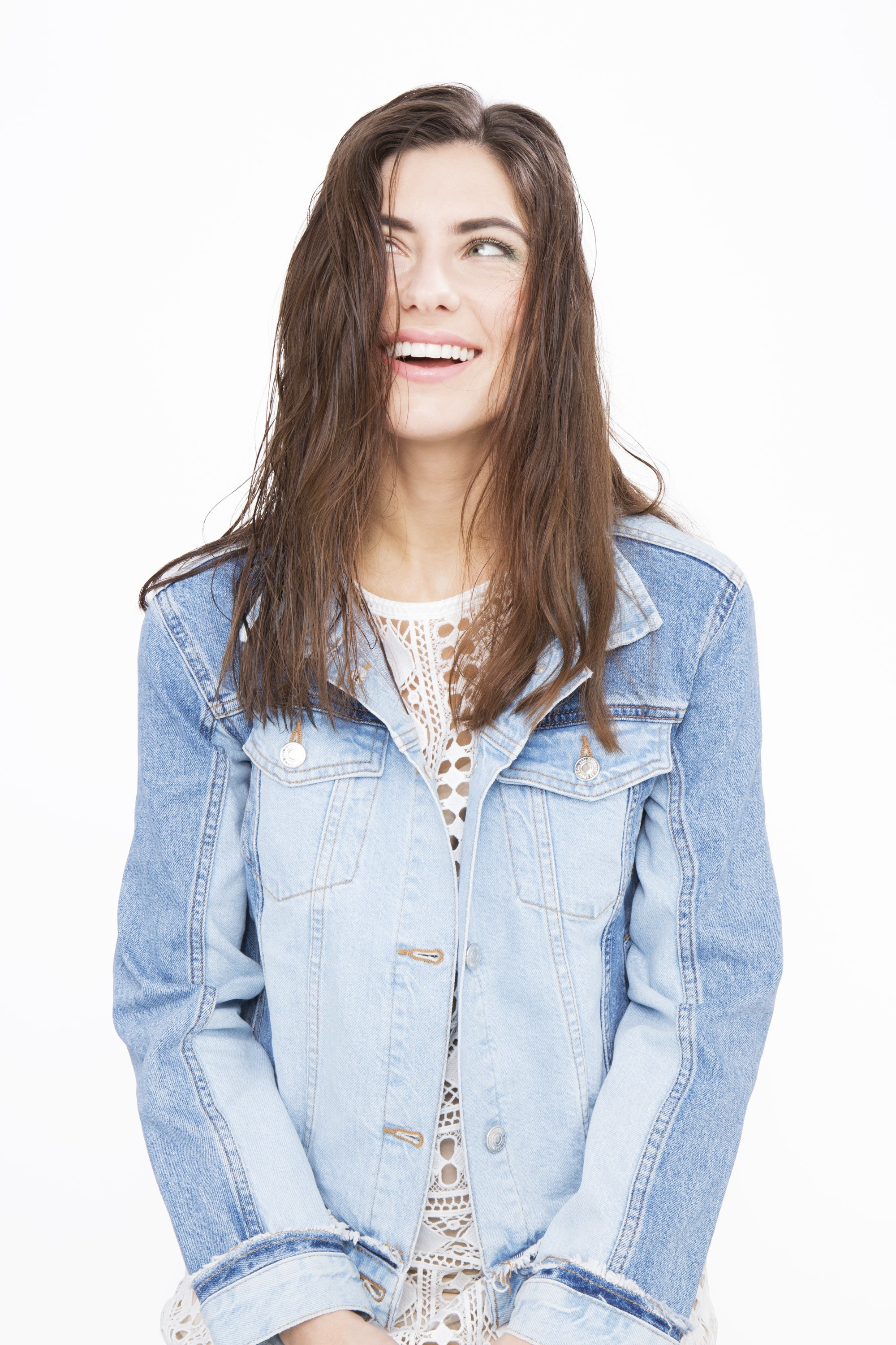 Deep conditioner: Brunette model wearing a denim jacket with damp freshly-washed hair