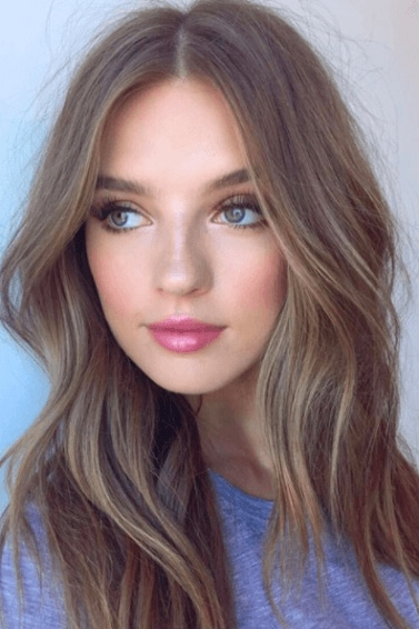 natural medium toned brown hair with soft highlights on long haired model