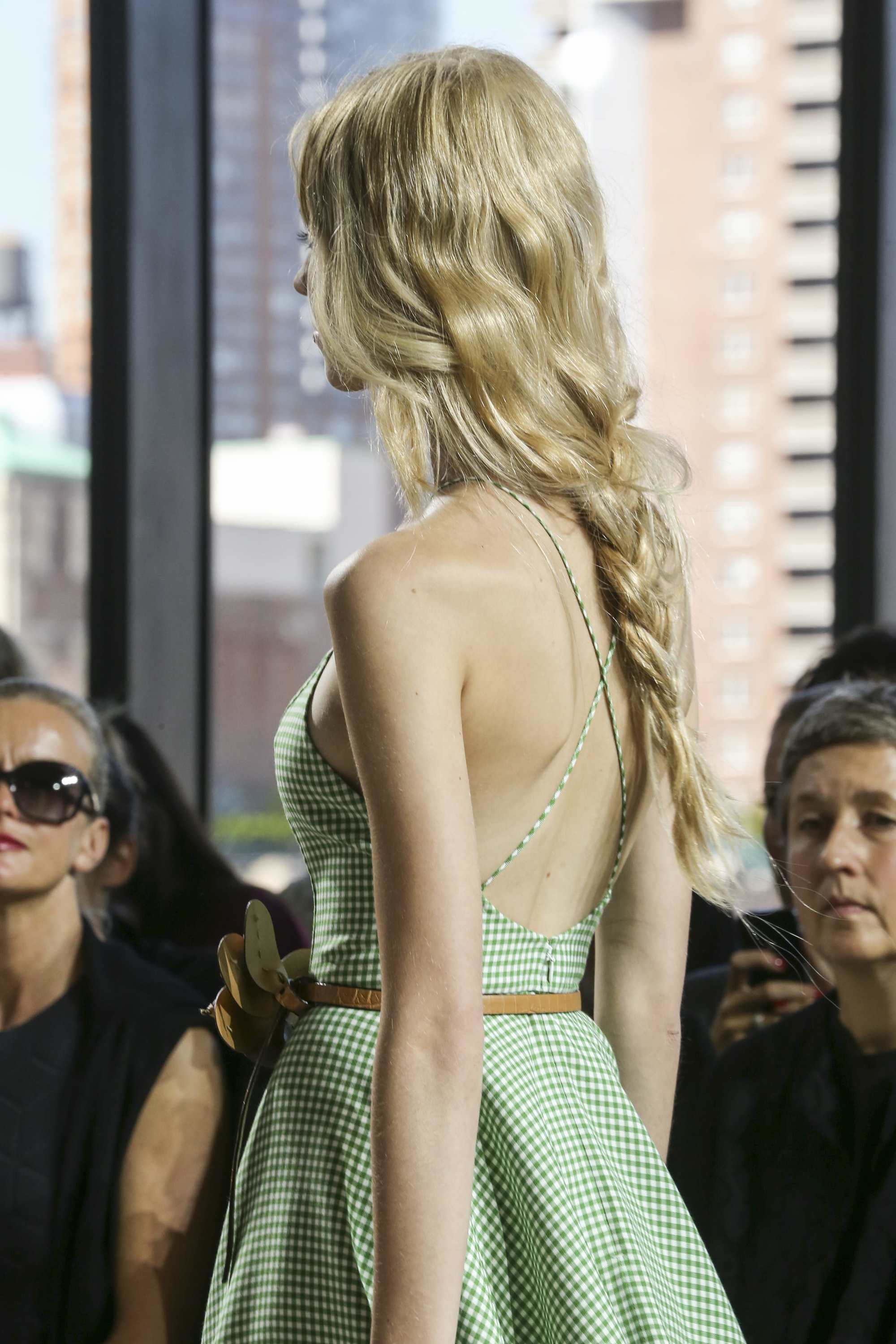 runway shot of a blonde model with a loose braid