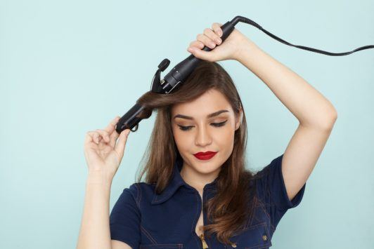 brown hair model using curling wand