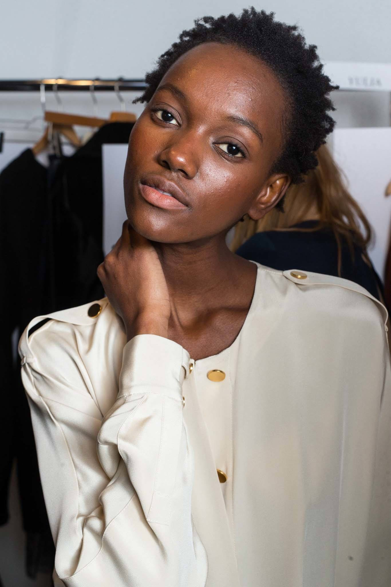different textures of natural hair: backstage shot of model with kinky hair