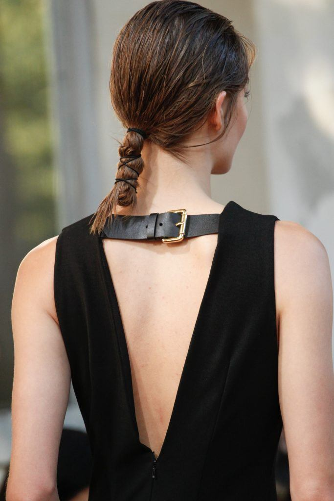 backshot of model with wrapped up textured ponytail