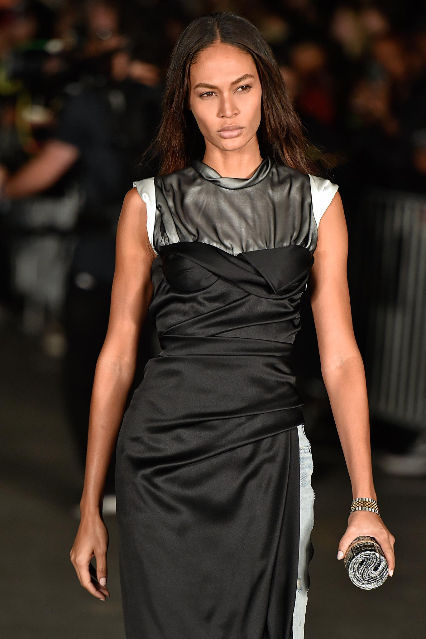 Joan Smalls on the runway with straight black hair