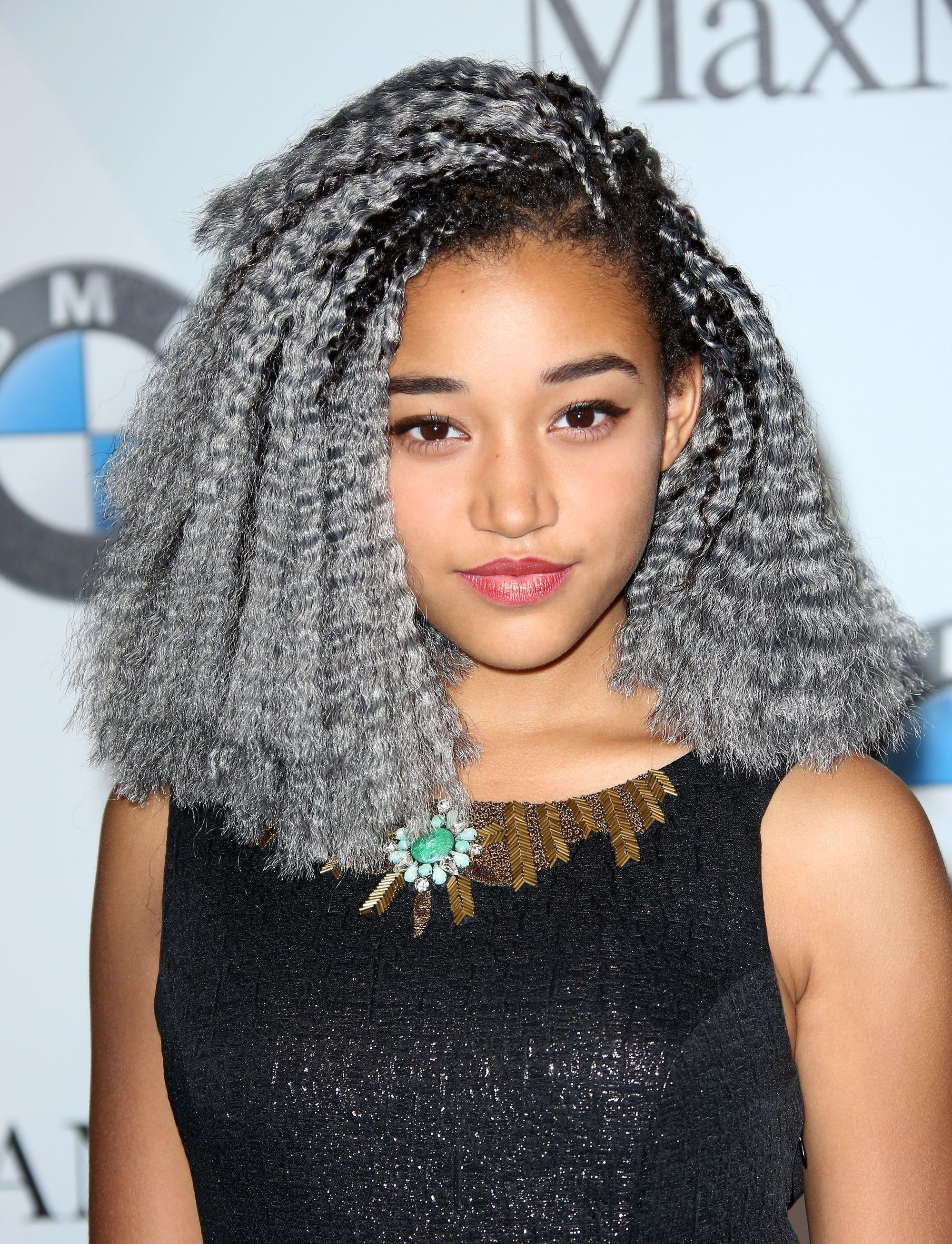 close up shot of amandla stenberg with silver grey hair crochet hairstyle