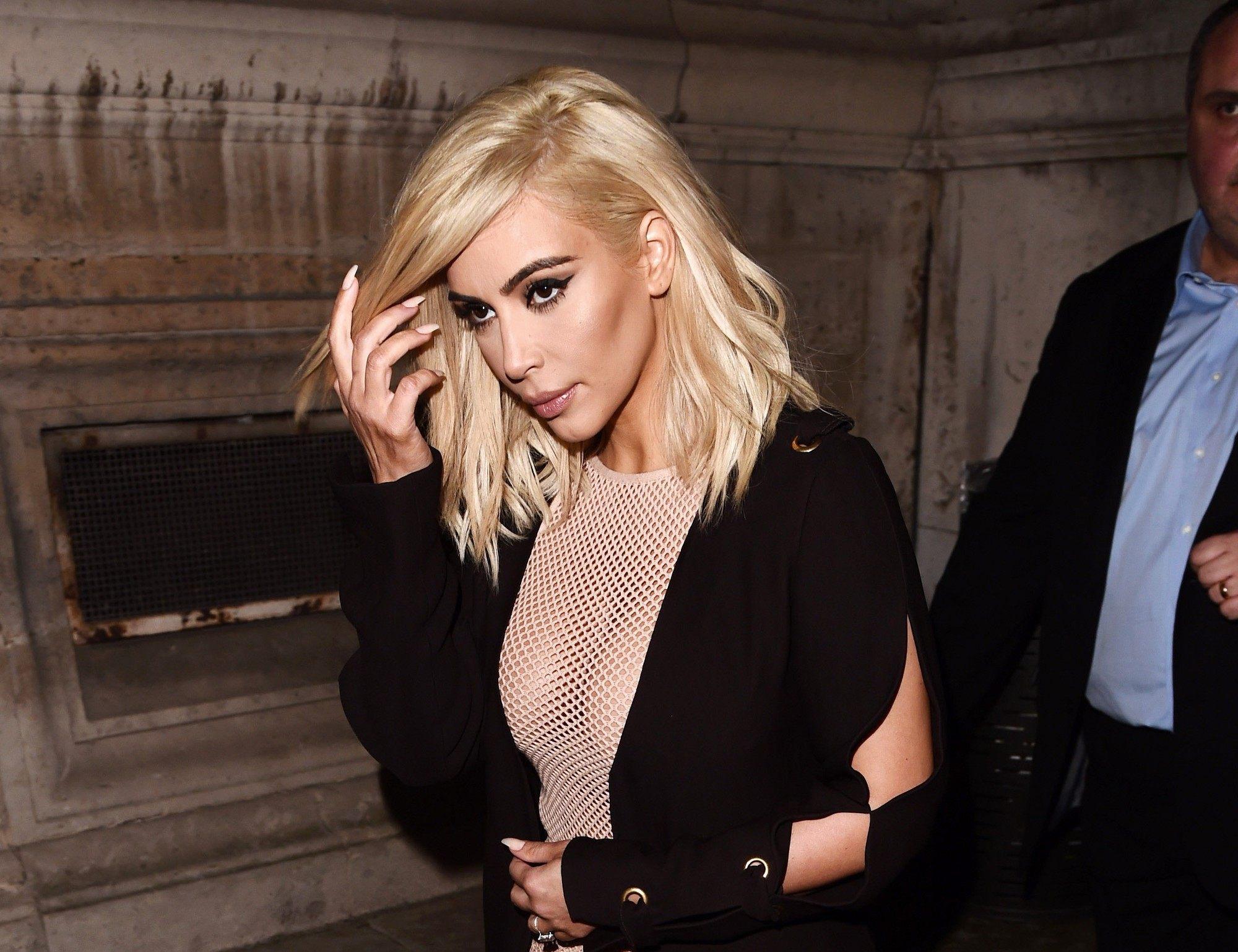 shot of kim kardashian west with blonde buttery hair