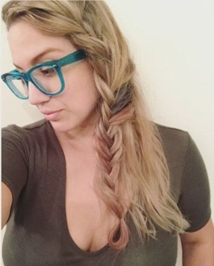 blonde woman taking a selfie with her hair in a half boho braid
