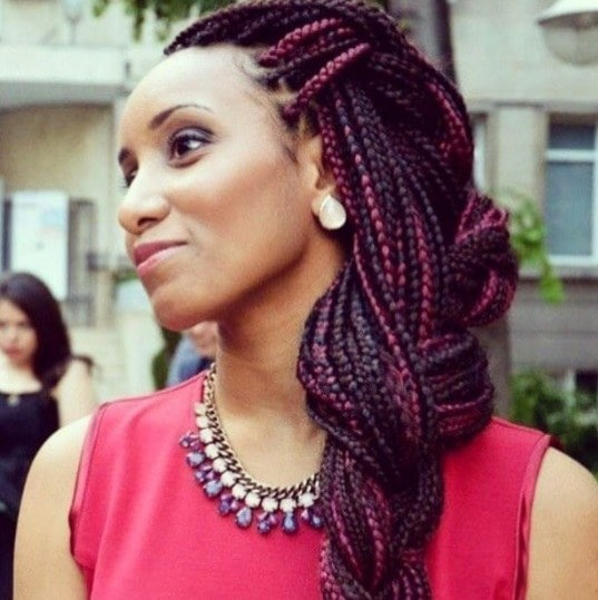 woman with red box braid hair in a braided hairstyle