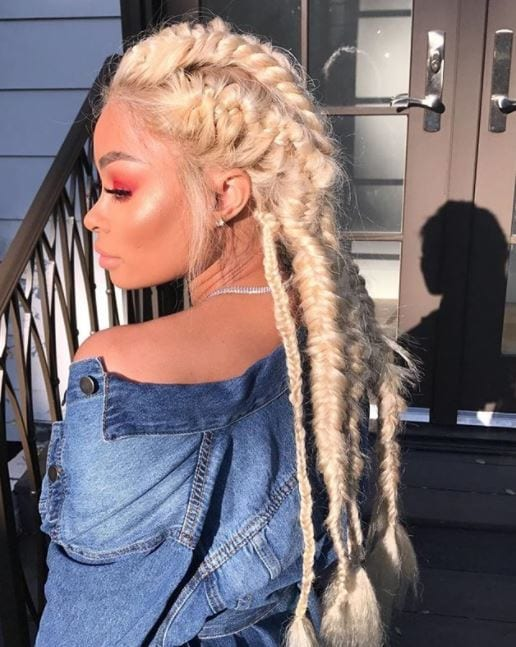 Side view of Blac Chyna with platinum blonde hair in full braided finish