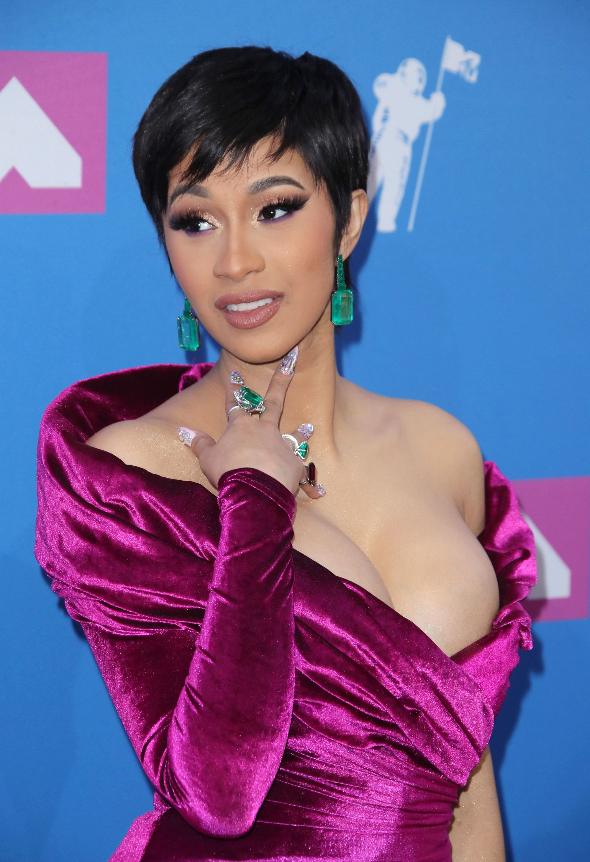 Close up shot of Cardi with a dark, short choppy pixie haircut on the VMA red carpet.