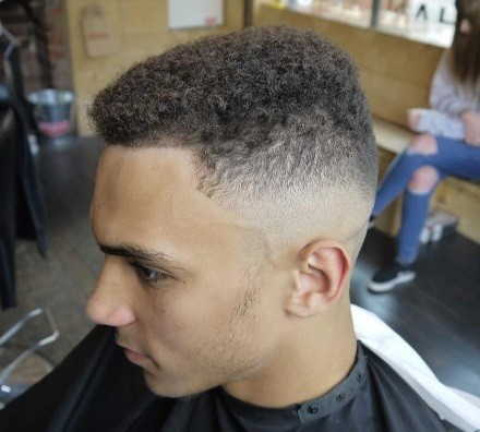 man with a classic bald taper fade haircut