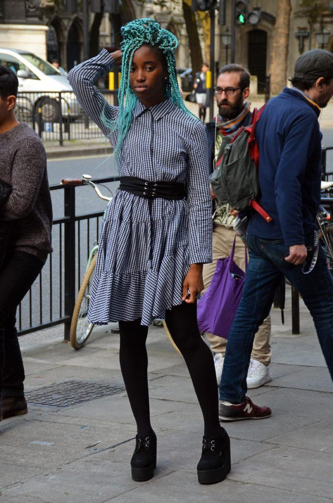 street style blogger at london fashion week with teal blue box braids
