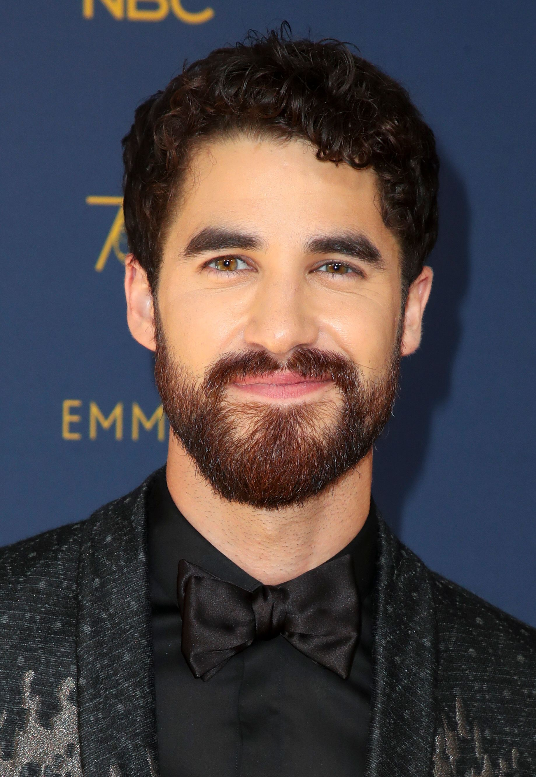 American Crime Story actor Darren Criss at the 2018 Emmy Awards with dark curly hair
