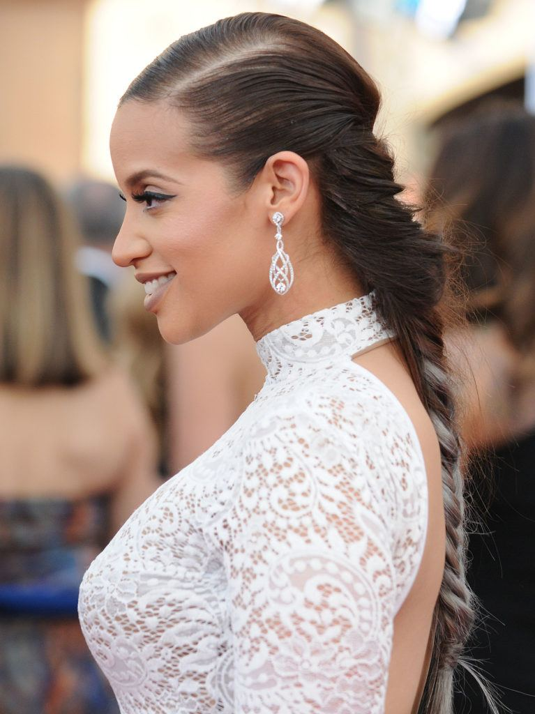 side shot of dascha polanco with dark brown hair with silver grey hair ombre on the red carpet