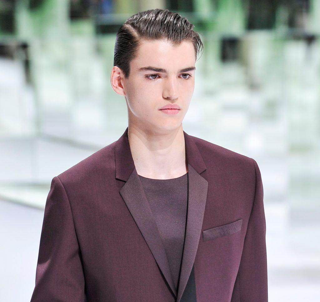 male model at dior with shiny comb over hair