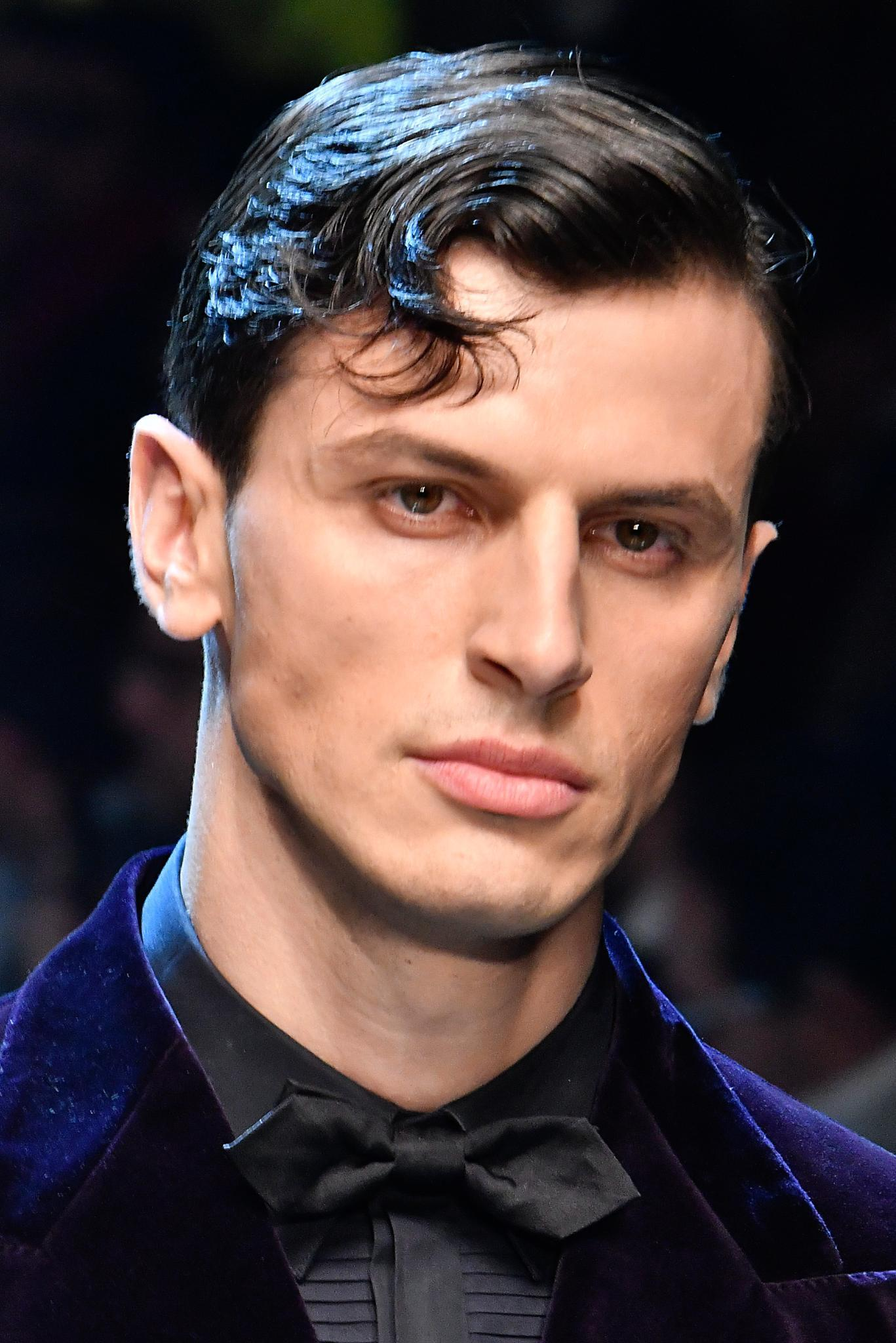 shot of male model with slick side hair and a fringe on the d and g runway