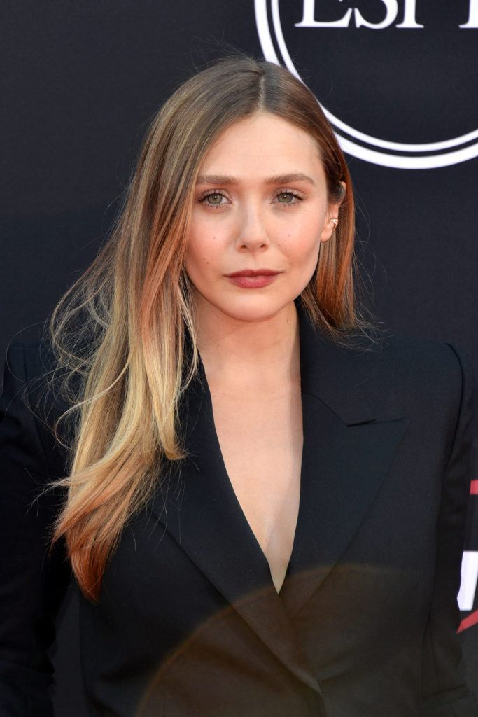 actress elizabeth olsen with bronde long straight hair balayage