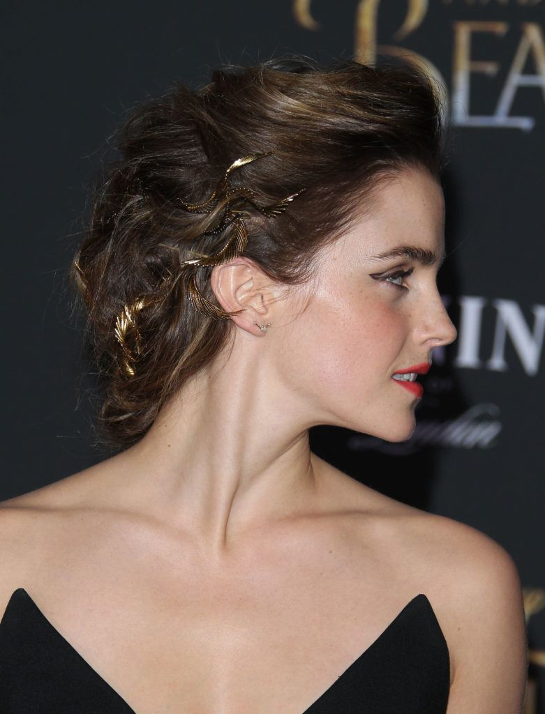 Emma Watson brown hair in braided updo shown from side angle