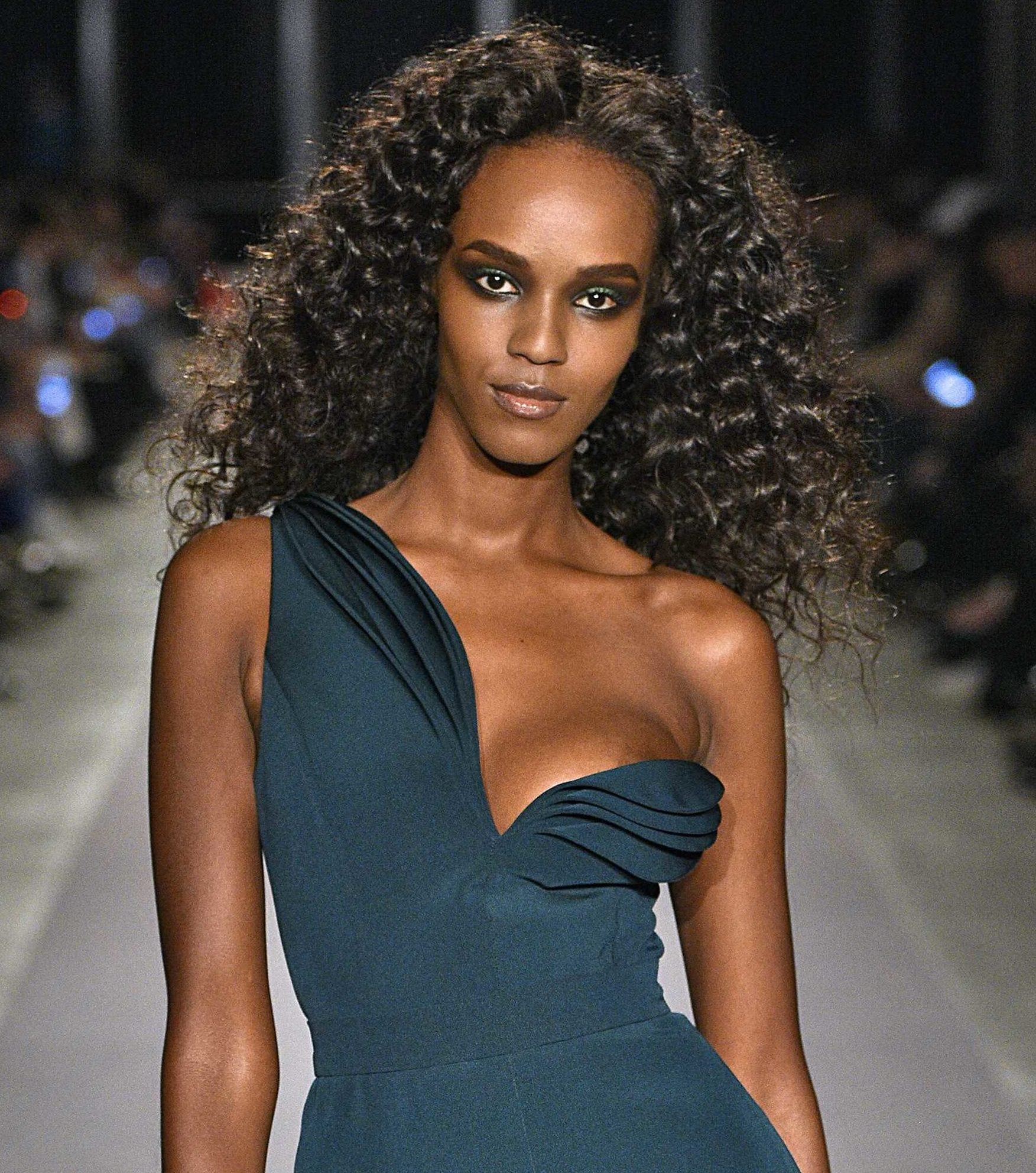black runway model with flat twist out curly hair