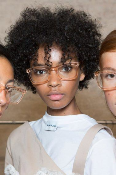 anti-frizz spray guide: shot of 3 models with 3 different hair types backstage